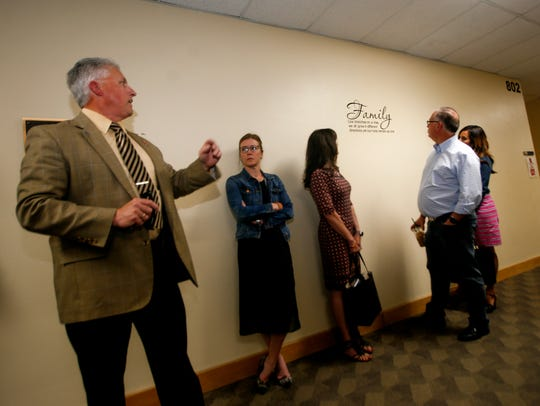 Aztec Municipal School District Superintendent Kirk Carpenter, left, talks with members of the Legislative Education Study Committee Tuesday during a tour of Aztec High School.