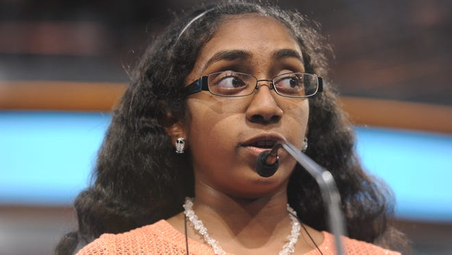 """Nila Dhinaker of Gilbert correctly spells """"apothecary"""" in Round 3 of the 2014 Scripps National Spelling Bee."""