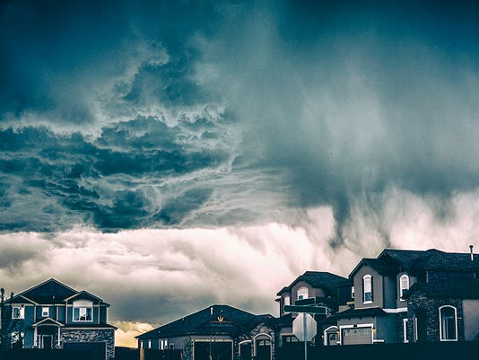 Dramatic storm clouds over residential neighborhood. Colorado, USA