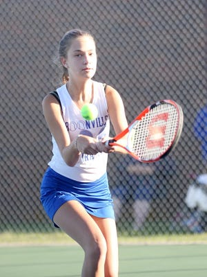 Boonville's No. 3 singles player Arjiana Webster hits a backhand Monday night against Father Tolton's Claire Condict at the high school tennis courts. Webster fell to Condict 8-1. The Lady Pirates also dropped the match against Father Tolton 6-3.