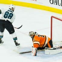 Sharks defenseman Brent Burns (88) scores the game-winning goal during a shootout against Philadelphia Flyers goalie Steve Mason (35) on Saturday at Wells Fargo Center.