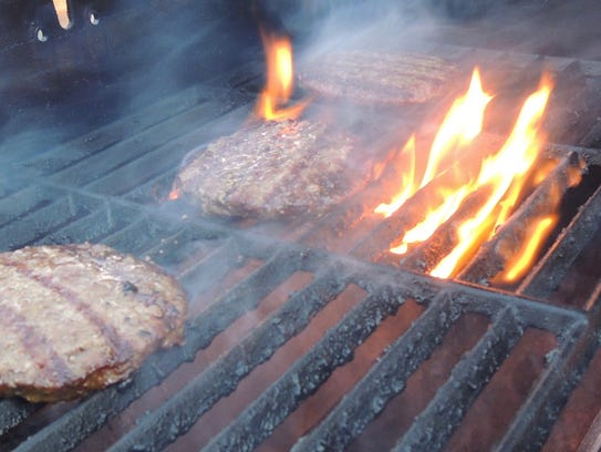 Burgers on the grill at Tiger Field during a Colt 45s