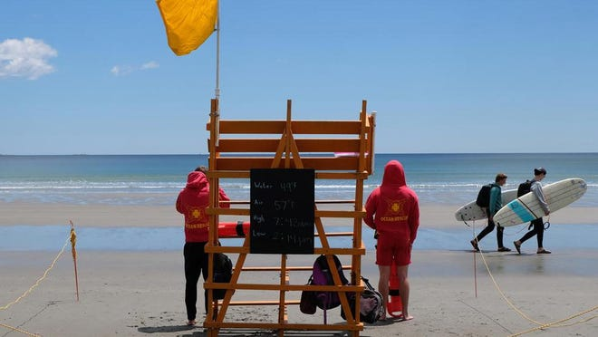 Lifeguards assess the scene at Jenness Beach earlier this week.