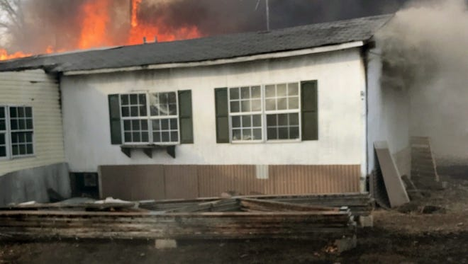 A wildfire was triggered when a pile of chicken manure caught fire in a barn near Charleston, AR.