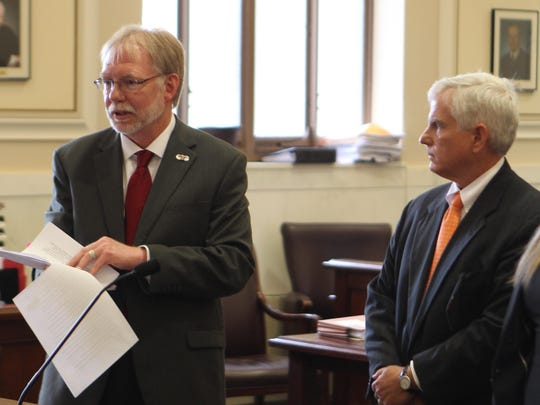 "Paul Croushore, left, attorney for Crysta and Stephen Pleatman, tells Judge Jody Luebbers that although Crysta Pleatman is on a witness list in a $360,000 civil suit, she was ""not in the area."" At right is Charles Reynolds, attorney for Grant Troja, who is suing the Pleatmans for breach of contract over the purchase of an Indian Hill home."