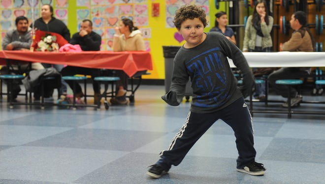Vincenzo Sarlo, 5, dances by himself during the Valentines Dance at Roger Corbett Elementary in Reno.