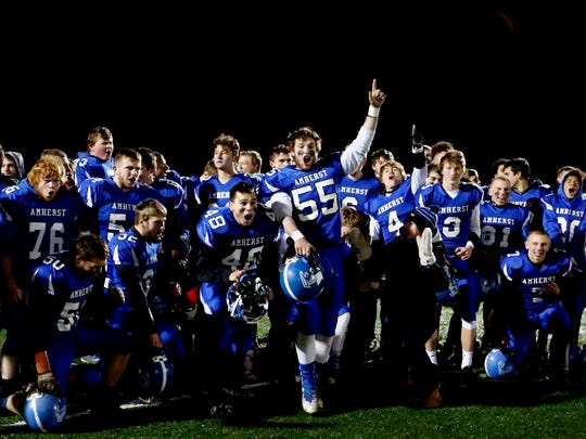 Amherst players celebrate after their win of the Division 5 playoff game between Amherst and Grantsburg on November 10, 2017, at Stanley-Boyd High School in Stanley, Wis.
