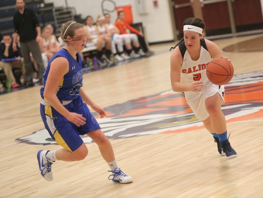 Galion's Julie Clouse keeps the ball away from Ontario's