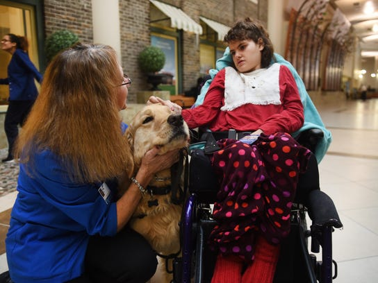Therapy dogs such as Benson provide patients such as