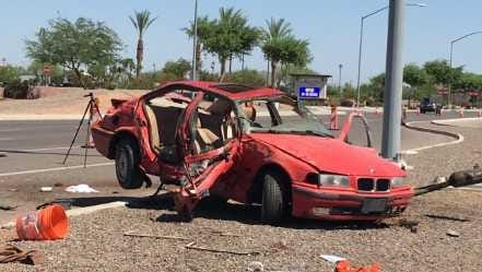Five teens were involved in a crash after the driver of a red BMW 325i headed northbound on Power Road ran a red light and rolled several times at Loop 202 south.