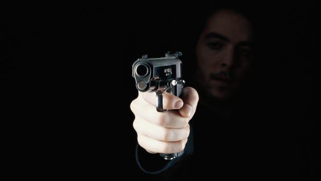 Man holding gun, close-up