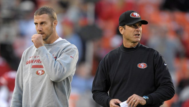 Alex Smith, left, and Jim Harbaugh with the San Francisco 49ers in 2012.