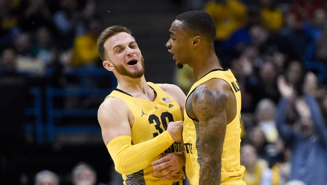 Marquette guard Andrew Rowsey (left) celebrates with teammate Duane Wilson after Rowsey drained a three-pointer vs. DePaul on Saturday at the BMO Harris Bradley Center.