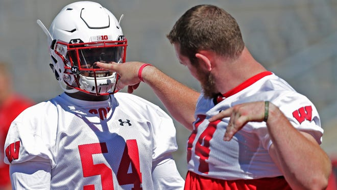 Defensive end Conor Sheehy (right)) clowns around with linebacker Chris Orr during Wisconsin's first training camp practice Saturday at Camp Randall Stadium in Madison.