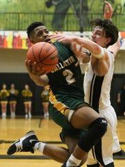 Gallatin High School player Zyun Mason puts up a shot