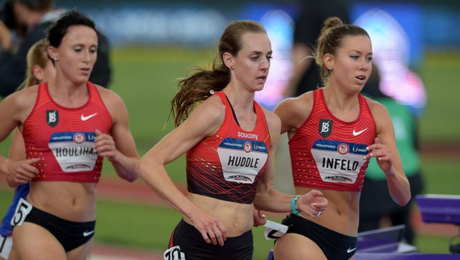 Shelby Houlihan (left), Molly Huddle (middle) and Emily Infeld( right) compete in the women's 5,000 meters Sunday at the U.S. Track and Field Team Trials at Hayward Field.