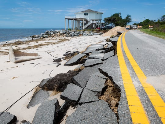 A section of Alligator Drive in Alligator Point, Fla., sits damaged on Sept. 3, 2016, after storm erosion from Hurricane Hermine.