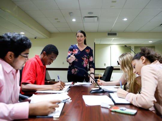 Attorney Trainer Nicole Pollock , center, works with