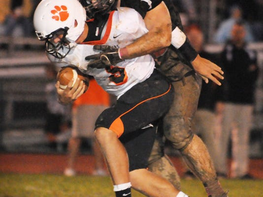 Palmyra's Jon Hicks wraps up East Pennsboro QB Austin Wilson during his senior season. Hicks will start his redshirt junior season at UConn with a home game against Villanova on Thursday, Sept. 3.