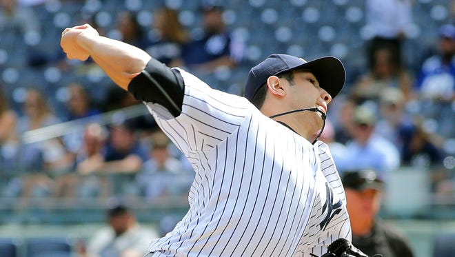 New York Yankees starting pitcher Luis Cessa pitches against the Tampa Bay Rays during the first inning at Yankee Stadium. The Rays won 4-2.
