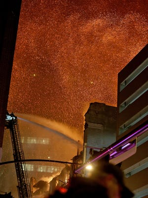 Hot ash and embers floated up into the sky as Des Moines firefighters fought a mulit-alarm fire as the former Younkers Building burned on Friday night March 29, 2014, as the fire burned intensely into Saturday morning.