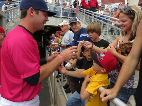 Travis Mattair signs autographs for fans before taking the field during in the 2013 season at Blue Wahoos Stadium. Mattair is now co-owner of Unlimited Training Academy in Pensacola. .