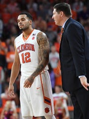 Clemson head coach Brad Brownell coaches fguard Avry Holmes (12) as the Tigers play Virginia during the 2nd half on Saturday, January 14,  2017 at Clemson's Littlejohn Coliseum.
