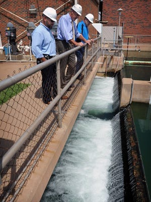 Project Manager Shawn Garcia, left, Public Works Director Russell Schreiber and Utilities Operations Manager Daniel Nix, right, look over the chlorine contact basin  in 2016, at the River Road Wastewater Treatment Plant. The basin is the final step of treatment before the water flows into the Wichita River and away from Wichita Falls. The new Indirect Potable Reuse system is permitted to capture about 16 millions gallons a day and instead pump it to Lake Arrowhead, where it will blend with the existing reservoir water. The average amount, though, should be 10-12 MGD.