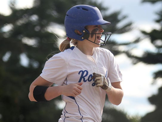 Assumption's Macyn Krings reacts as she rounds the