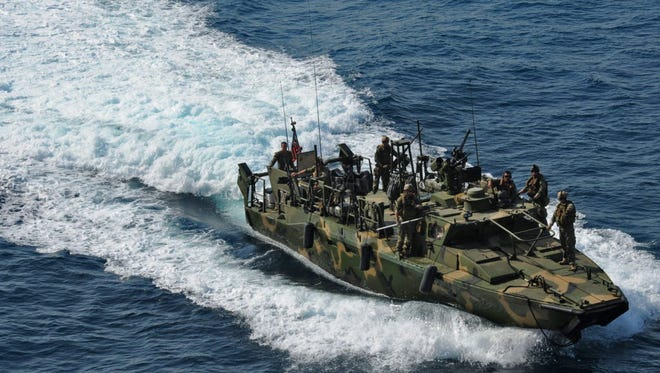 A U.S. Navy boat conducts an exercise in the Arabian Sea on June 12, 2012.