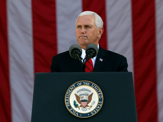 Vice President Mike Pence pauses while speaking during