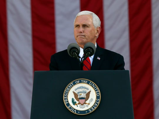 Vice President Mike Pence pauses while speaking during a Veterans Day ceremony at Arlington National Cemetery, Saturday, Nov. 11, 2017, in Washington, D.C.