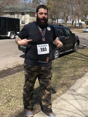 Aaron Firkus shared a photo and his story with Earth Day Run organizers. He ran in his first half-marathon after losing 200 pounds.