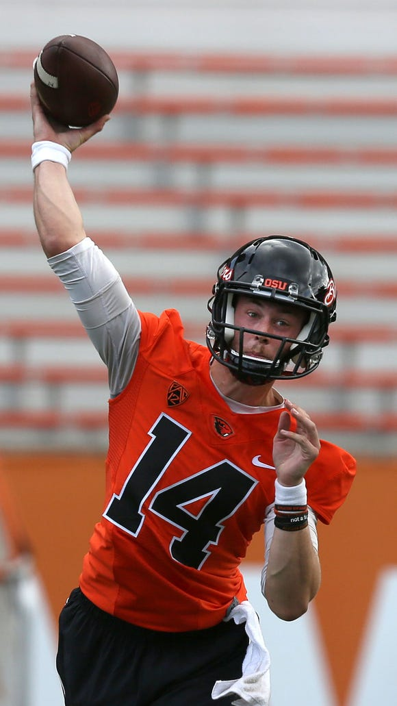 Oregon State quarterback Nick Mitchell makes a pass during the first day of fall practice on Saturday, Aug. 8, 2015, in Corvallis, Ore.