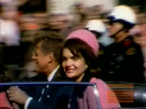 This image made from a home movie shows President John F. Kennedy and his wife, Jacqueline, moments before his assassination Nov. 22, 1963, in Dallas.