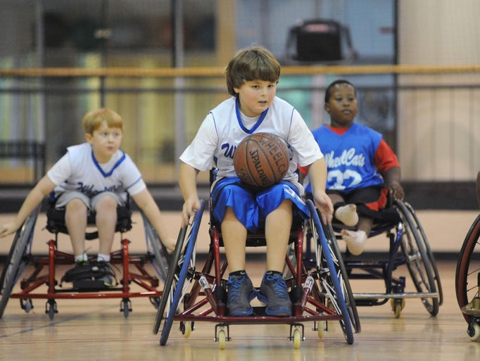 John Matthew Davis, center, heads down court on a fast-break asAiden Bridwell, left, and Clinton West keep pace during a Mississippi WheelCats practice on Saturday at Baptist Healthplex in Clinton.