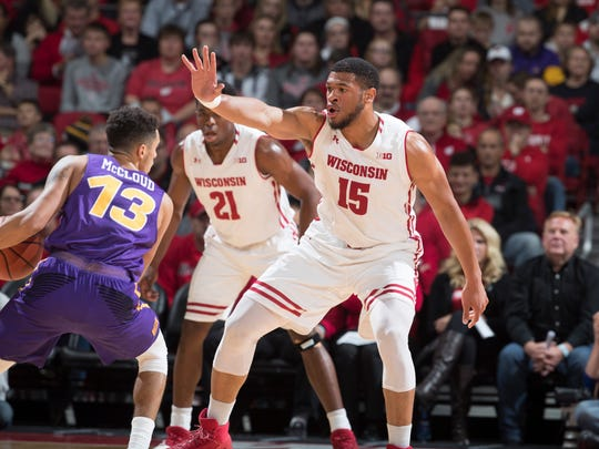 UNI's Juwan McCloud sizes up Wisconsin during the Panthers' 69-38 loss Wednesday at the Kohl Center.
