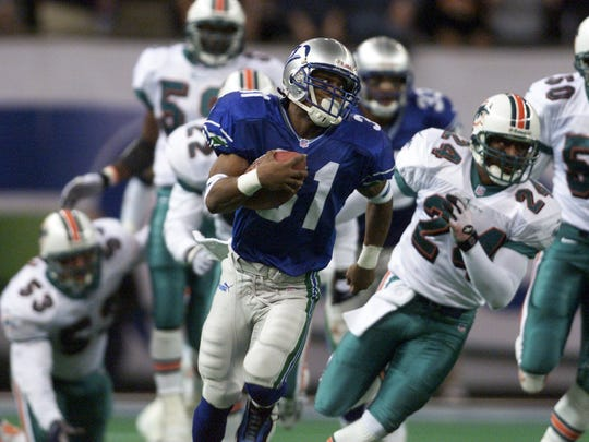 Former Matawan back Charlie Rogers returns a kickoff 85 yards for a touchdown against Miami in a wildcard playoff game in 2000.