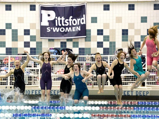 Pittsford swimmers take their celebratory dip after taking first place during the Section V Class A Swimming & Diving Championships at the Webster Aquatic Center, Friday, Nov. 3, 2017.