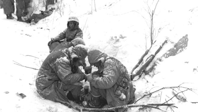 Members of the1st Marine Division at the Chosin Reservoir in Korea, Dec. 1950. The reservoir was the scene of a decisive battle in the war. The battle was fought in some of the roughest terrain and during some of the harshest winter weather conditions of the war.
