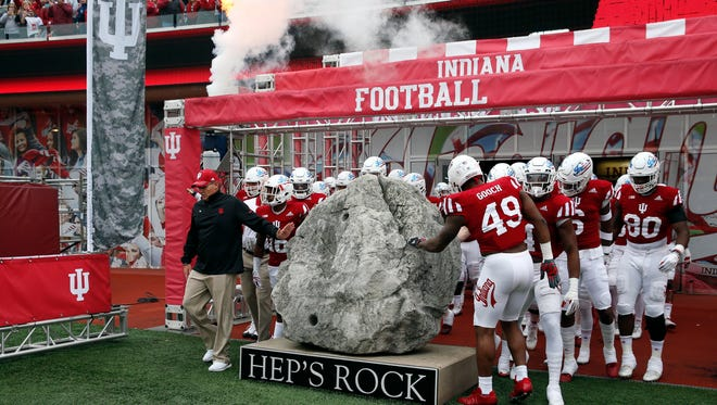 Indiana Hoosiers coach Tom Allen and the Hoosiers gather around to touch Hep's Rock before the game against the Wisconsin Badgers at Memorial Stadium.