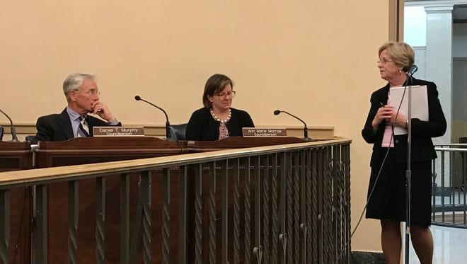 Elizabeth McKenzie, at right, speaks to the Glen Ridge Borough Council about the Baldwin Street development during an April 24 meeting.