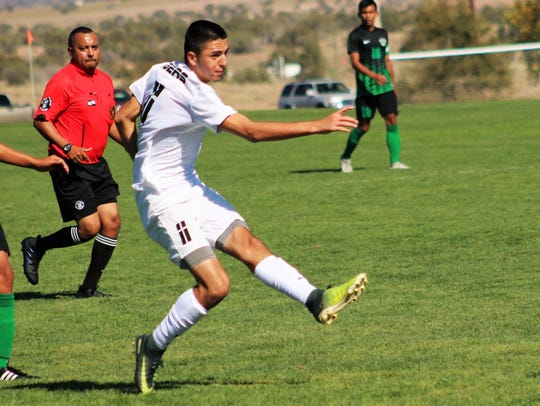 Alamogordo's Julian Torres takes a shot at the goal.