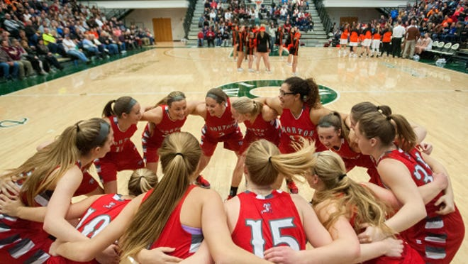 The Morton Potters huddle up after player introductions before facing Normal Community in the title game of the State Farm Insurance Holiday Classic on Saturday, Dec. 30, 2017 at the Shirk Center in Bloomington.