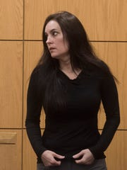 Ashley McArthur appears before Circuit Judge Jan Shackelford for a bond revocation hearing Monday, April 23, 2018. McArthur is accused of killing private detective Taylor Wright and burying her on a family member's property.
