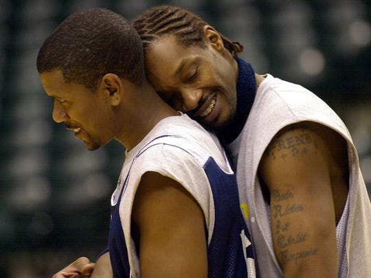 Pacer Carlos Rogers (right) jokingly leans on Jalen Rose following practice at Conseco Fieldhouse.