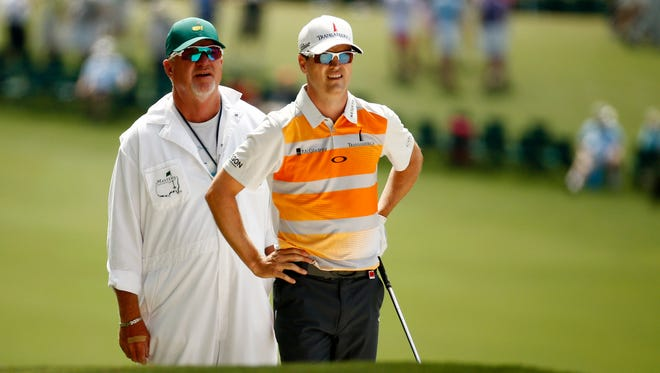 Zach Johnson and his caddy, Damon Green, plot strategy during Johnson's third-round 68 Saturday at the Masters