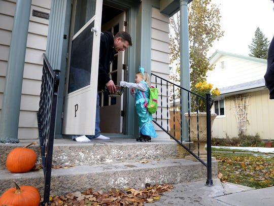 Mirabelle Heiser, age 2, picks out candy from Rick