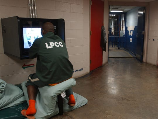 An inmate uses the new vidio visitation station, Tuesday