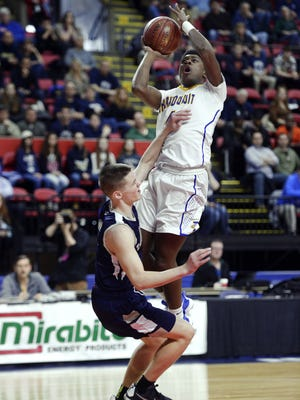 Irondequoit's Gerald Drumgoole, top, draws a foul on Lourdes' Aidan Hildebrand during the NYSPHSAA Boys Basketball Championships Class A final in Binghamton on March 19, 2017.